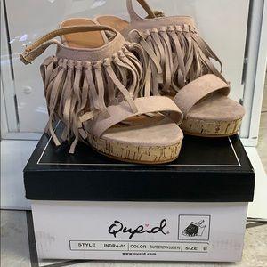 Tan fringe sandal wedge.
